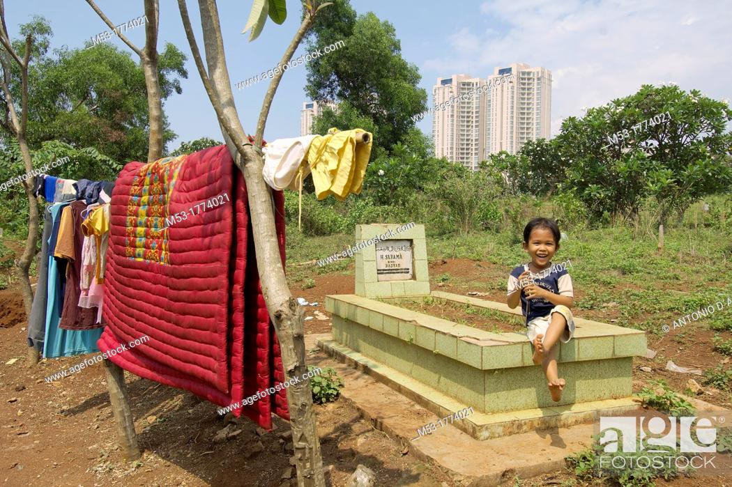 Stock Photo: an indonesian boy living in a makeshift camp in Menteng Dalam Cemetery  jakarta  indonesia  asia.