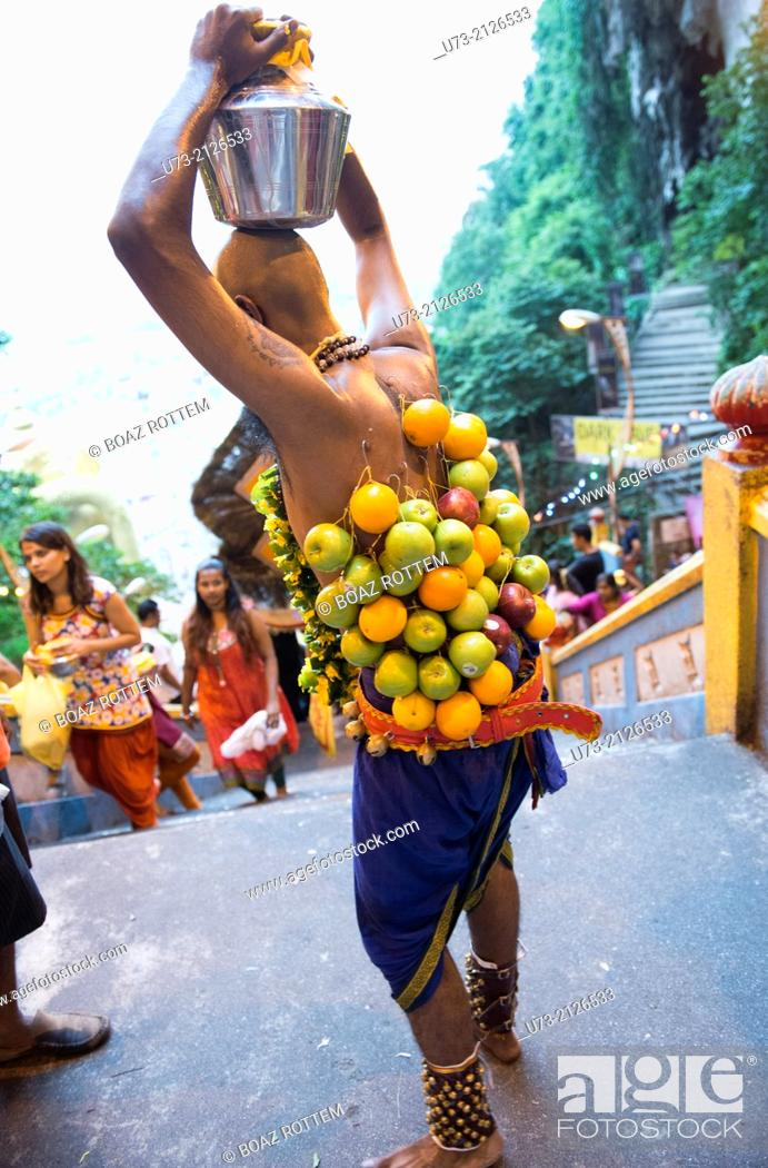Stock Photo: Bizarre scenes at the annual Hindu Thaipusam festival in KL, Malaysia.
