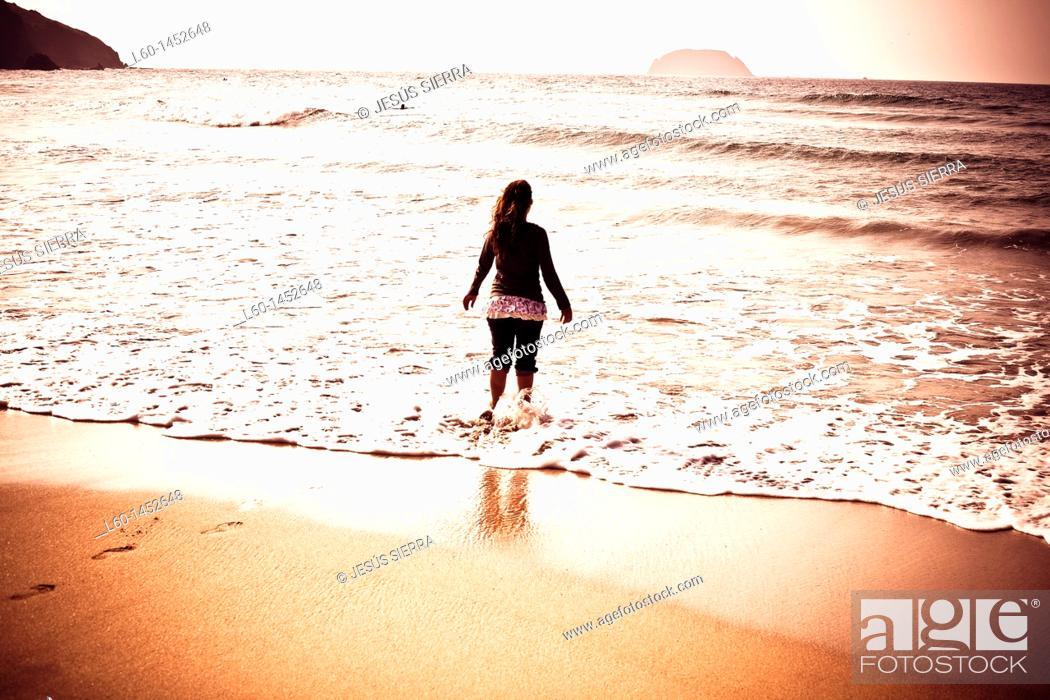 Stock Photo: Girl in Laga beach, Biscay, Spain.
