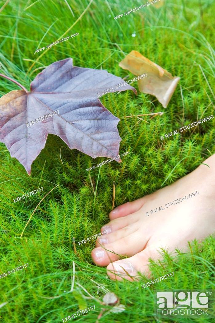 Stock Photo: Woman walking barefoot.
