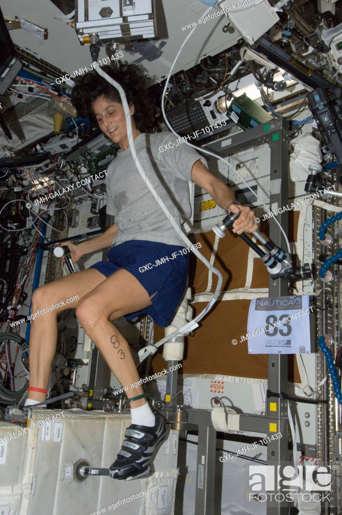 Stock Photo: NASA astronaut Sunita Williams, Expedition 33 commander, exercises on the Cycle Ergometer with Vibration Isolation System (CEVIS) in the Destiny laboratory of.