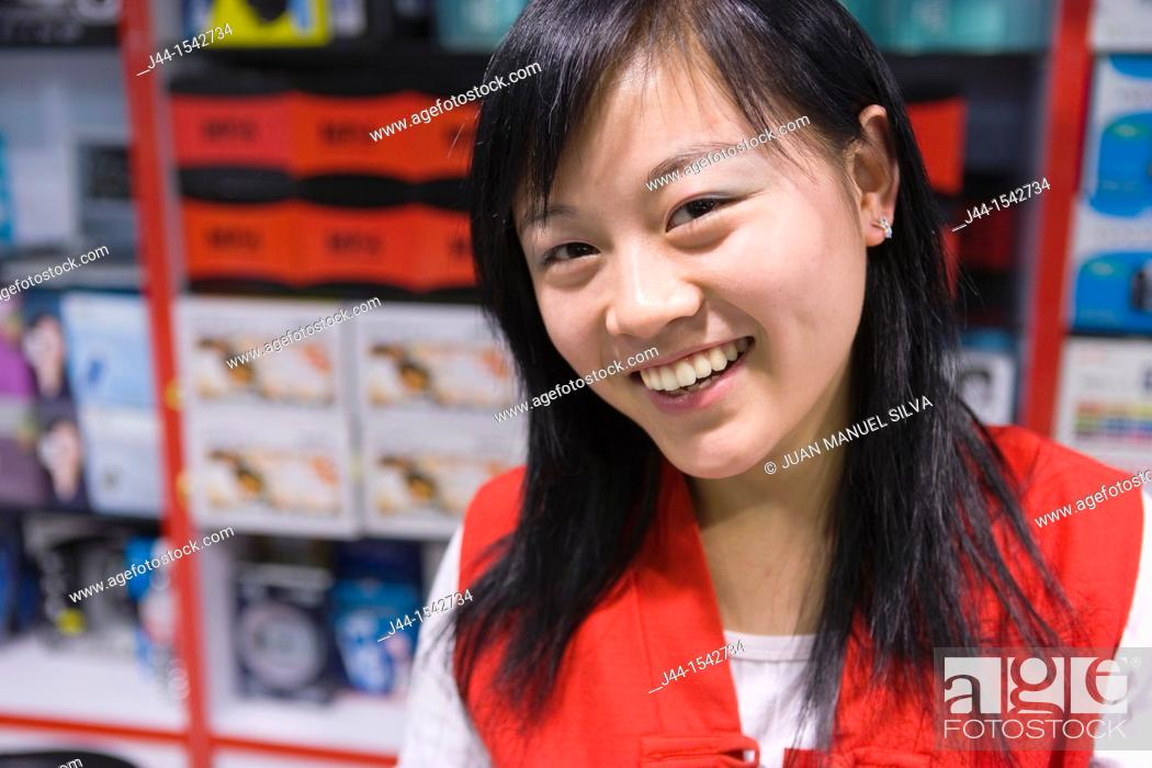 Stock Photo: Smiley and friendly chinese saleswoman in a store at Silk Market, Beijing, China.