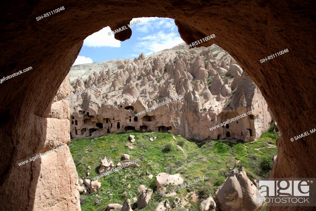 Stock Photo: As a result of the Erciyes Volcano eruption, thousands of years ago, a hard cap rock was created on tall pillar and formed the fairy chimneys.