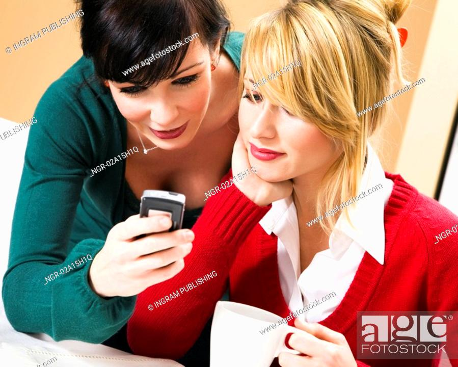 Stock Photo: home life: friends talking on the phone.