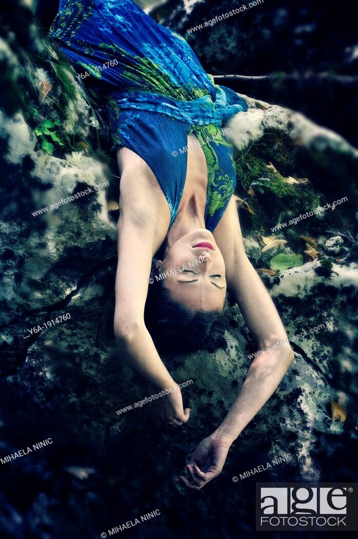 Stock Photo: Young woman lying upside down.