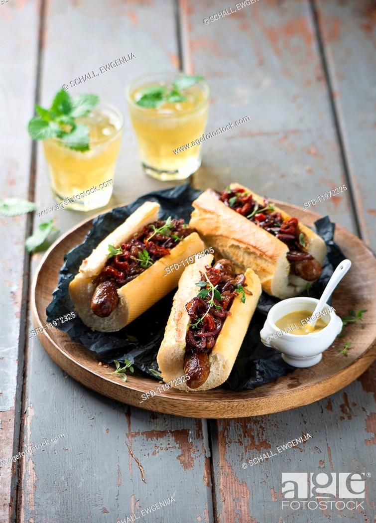 Stock Photo: Hot dogs with caramelised onions and mastered.