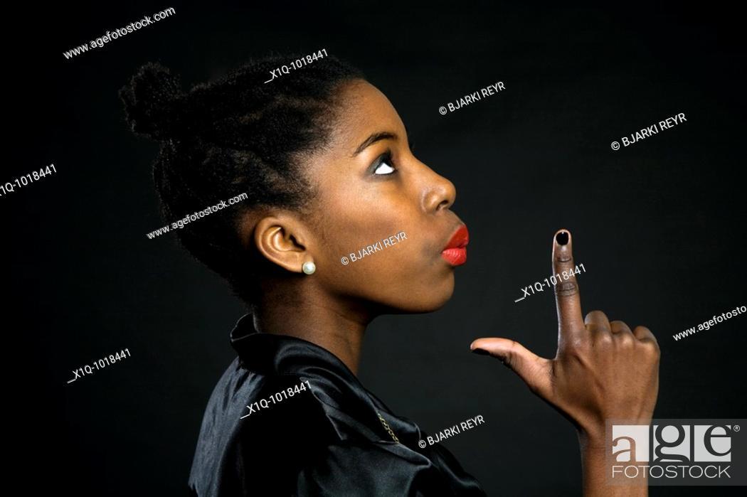 Stock Photo: Teenage girl pretending to blow the smoke off a gun.