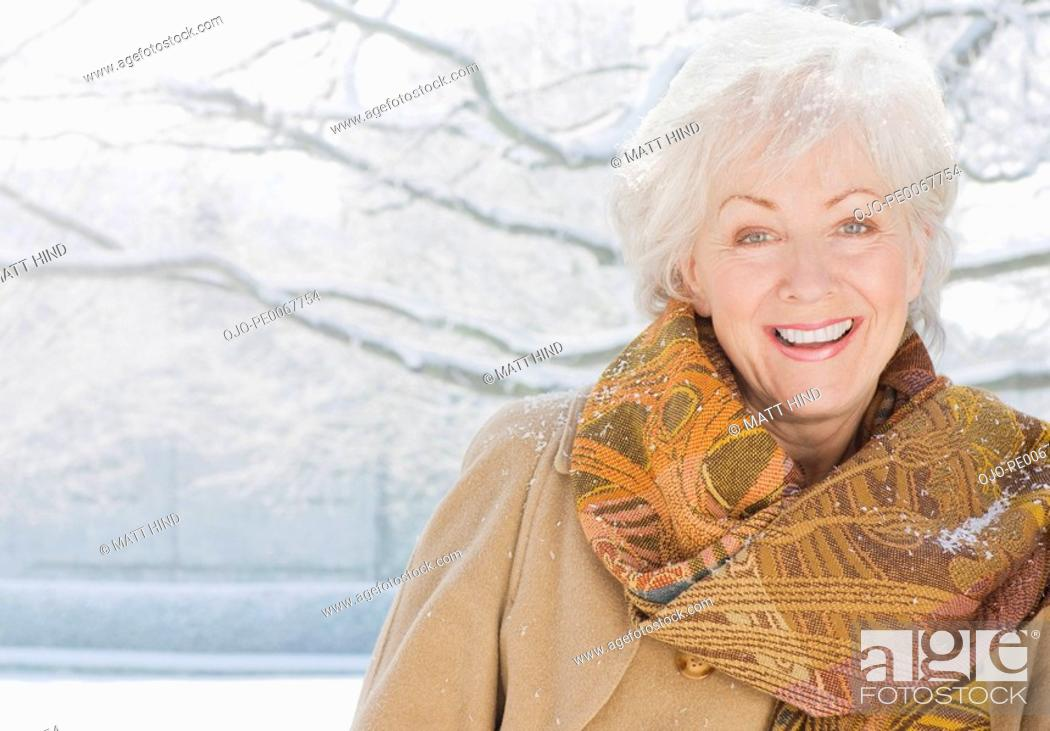 Stock Photo: Woman smiling in snow.