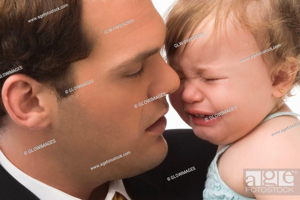 Stock Photo: Close-up of a young man consoling his daughter.