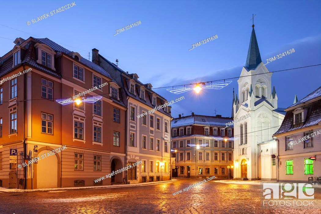 Stock Photo: Winter dawn at Our Lady of Sorrow church in Riga old town, Latvia.