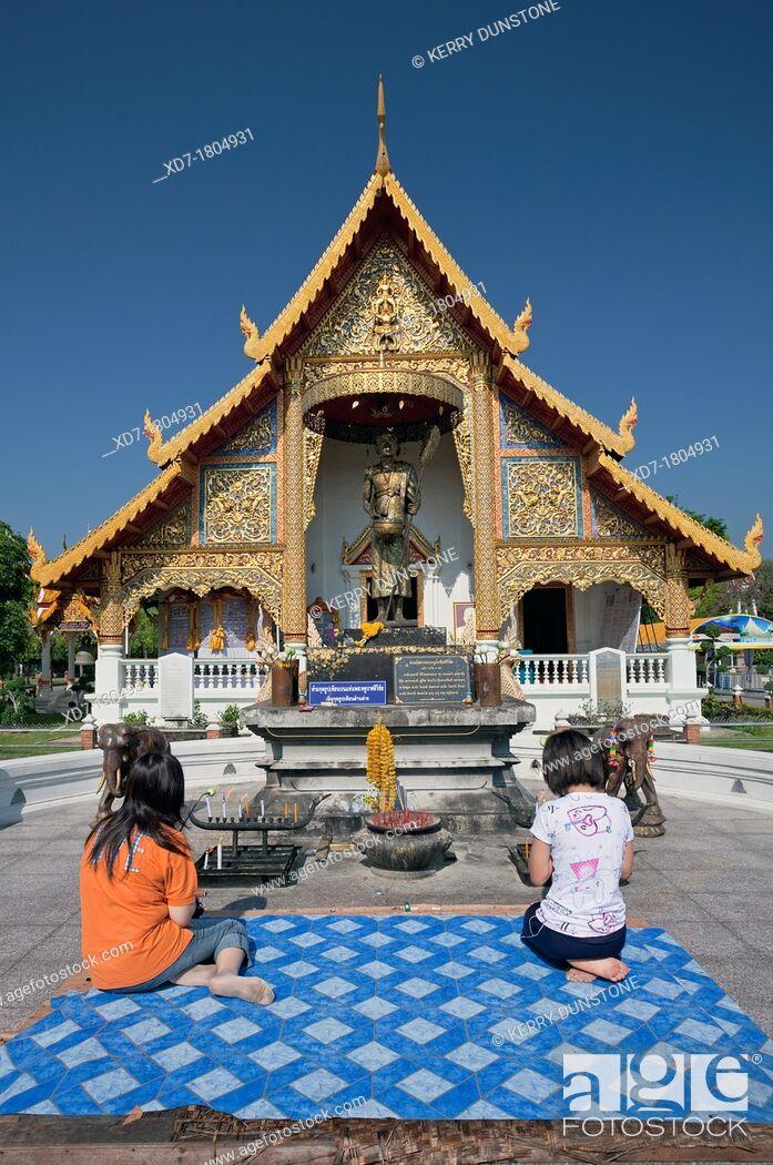 Stock Photo: Women in prayer outside Wat Phra Singh, Chiang Mai, Thailand.