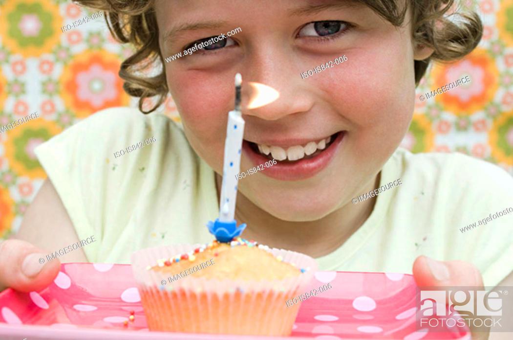 Stock Photo: Girl with birthday cupcake.