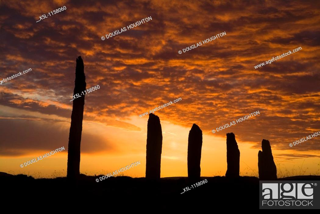 Stock Photo: RING OF BRODGAR ORKNEY Neolithic standing stones orange and grey sunset cloudy dusk sky.