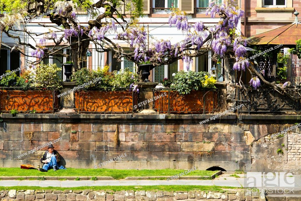 Stock Photo: Tourists on the Banks of the River Ill in Strasbourg, Alsace, France.