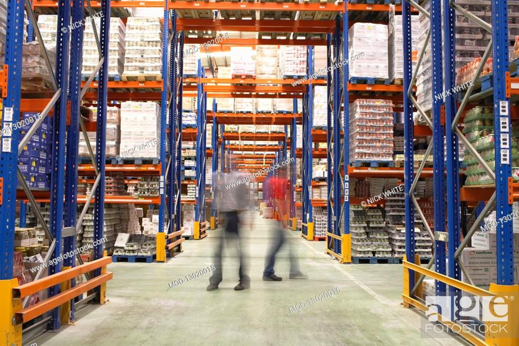 Stock Photo: Men Walking in Warehouse.