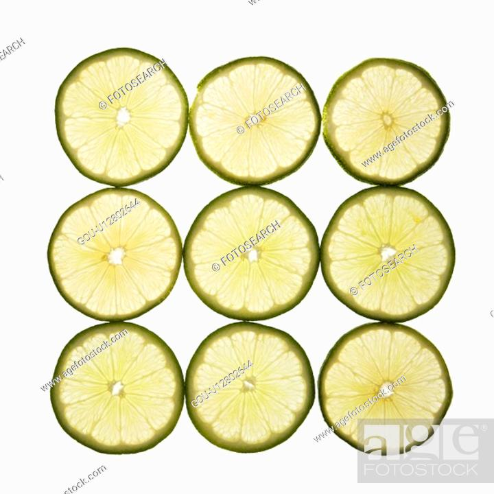 Stock Photo: Lime slices arranged in square design on white background.