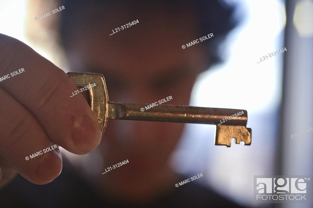 Stock Photo: Man holding key.