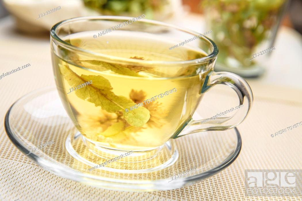 Stock Photo: Glass Cup with Linden tea on the table.