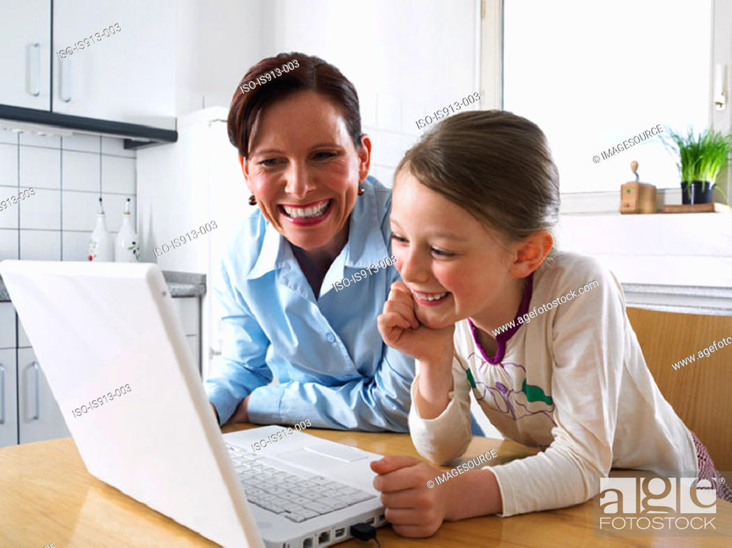 Stock Photo: Mother and daughter using laptop computer.