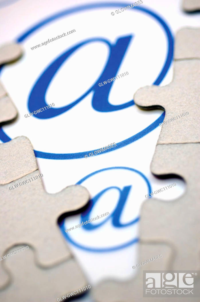 Stock Photo: Close-up of jigsaw puzzle over an 'at' symbol.