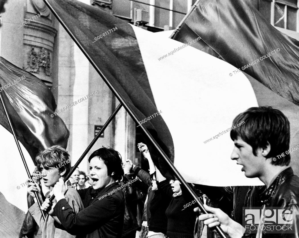 Stock Photo: PARIS STUDENT REVOLT, 1968.University students marching through the streets of Paris, France, carrying banners and shouting slogans.