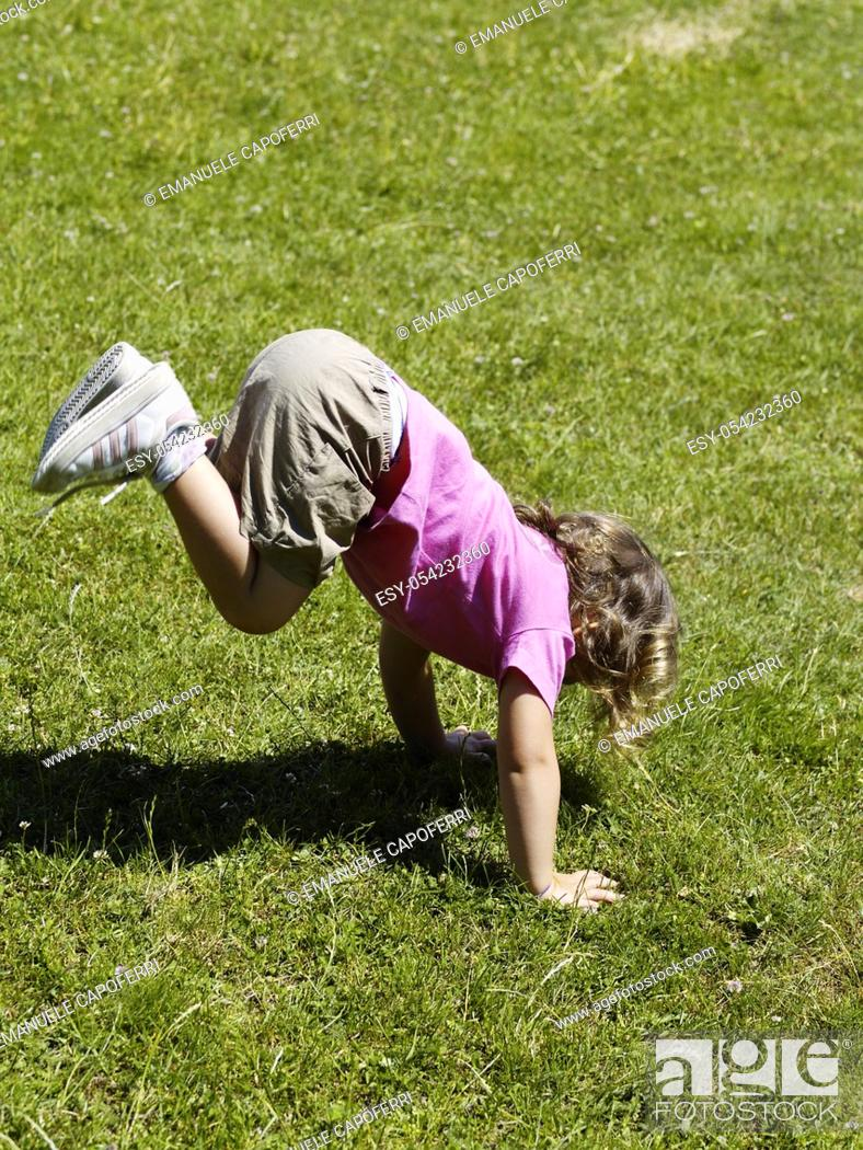 Stock Photo: Girl playing on the lawn.