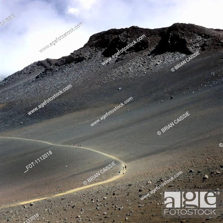 Stock Photo: Hikers on a trail in the Haleakala National Park.