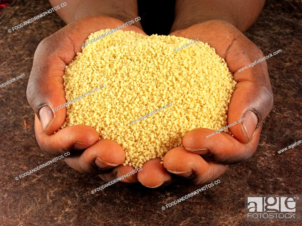 Stock Photo: Man's Hands Holding Couscous.