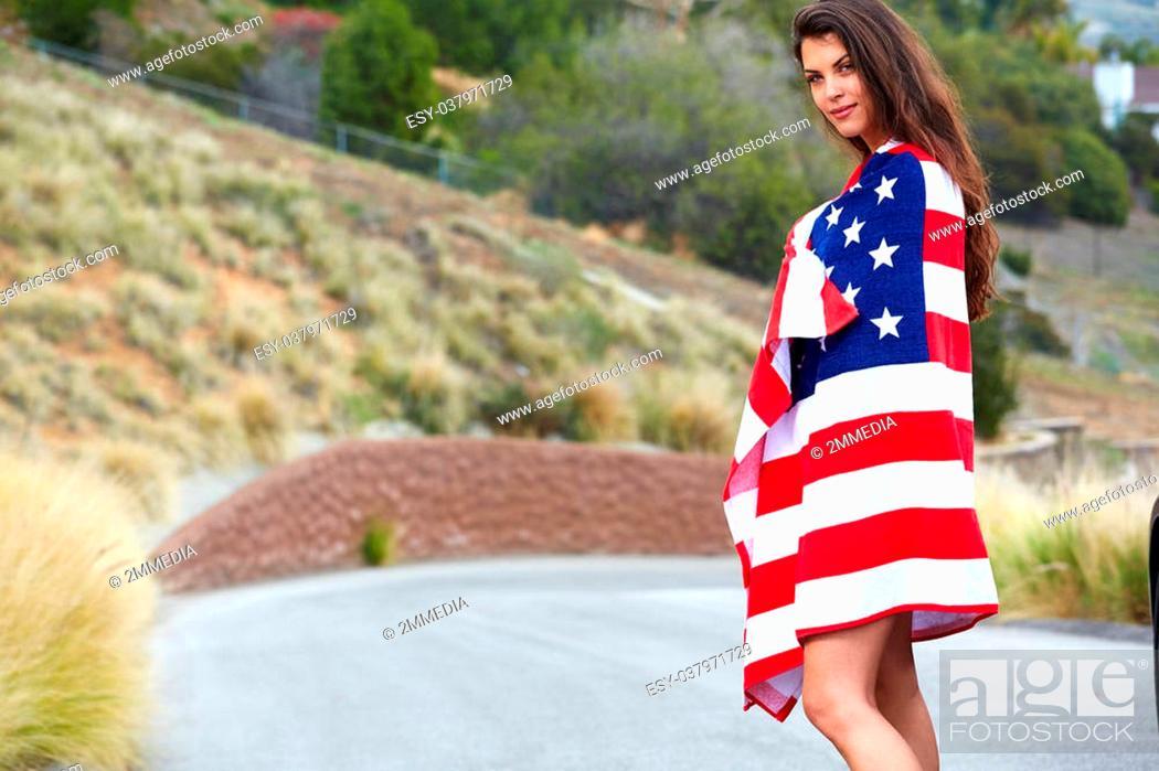 Photo de stock: Woman wearing American Flag, walking on the street.