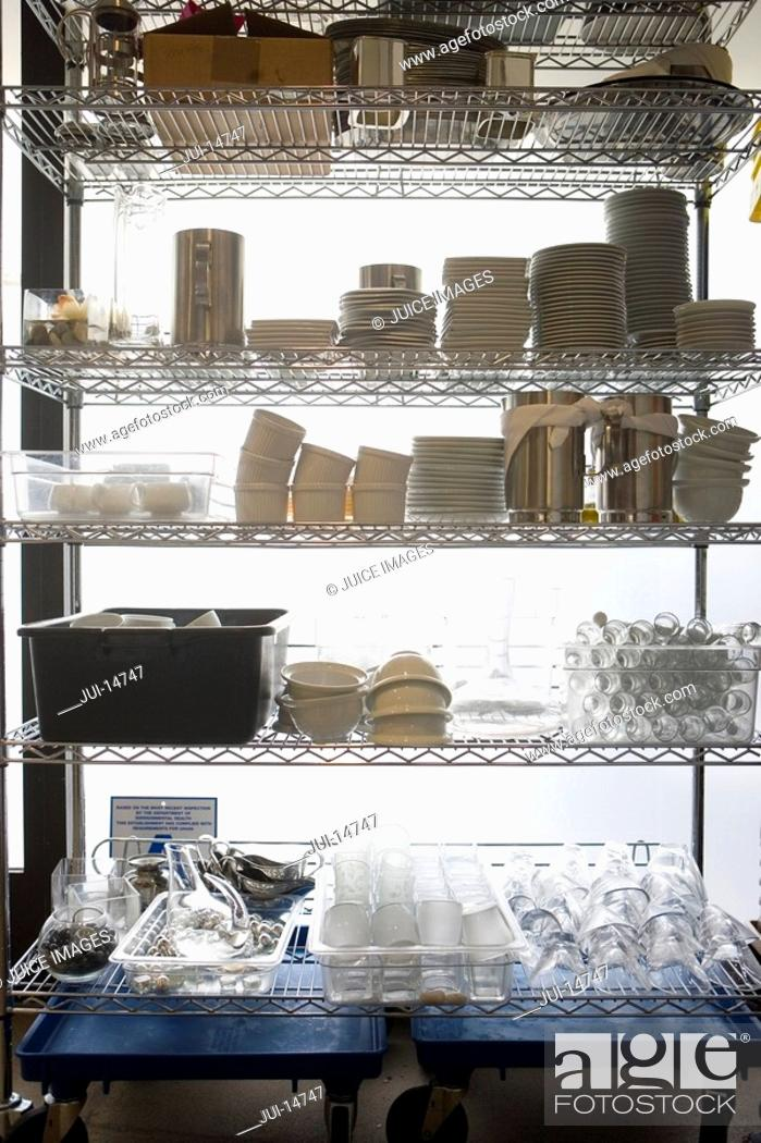 Stock Photo: Dishes and containers on kitchen rack.
