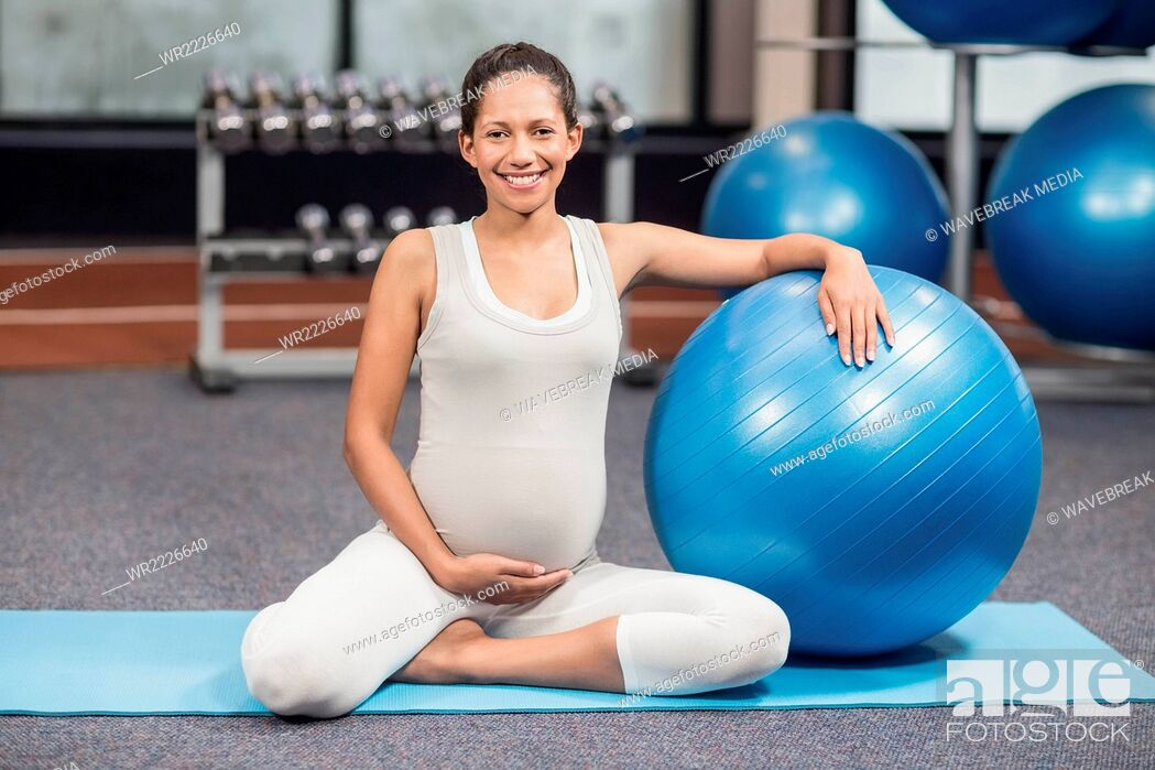 Stock Photo: Pregnant woman exercising with fitness ball.