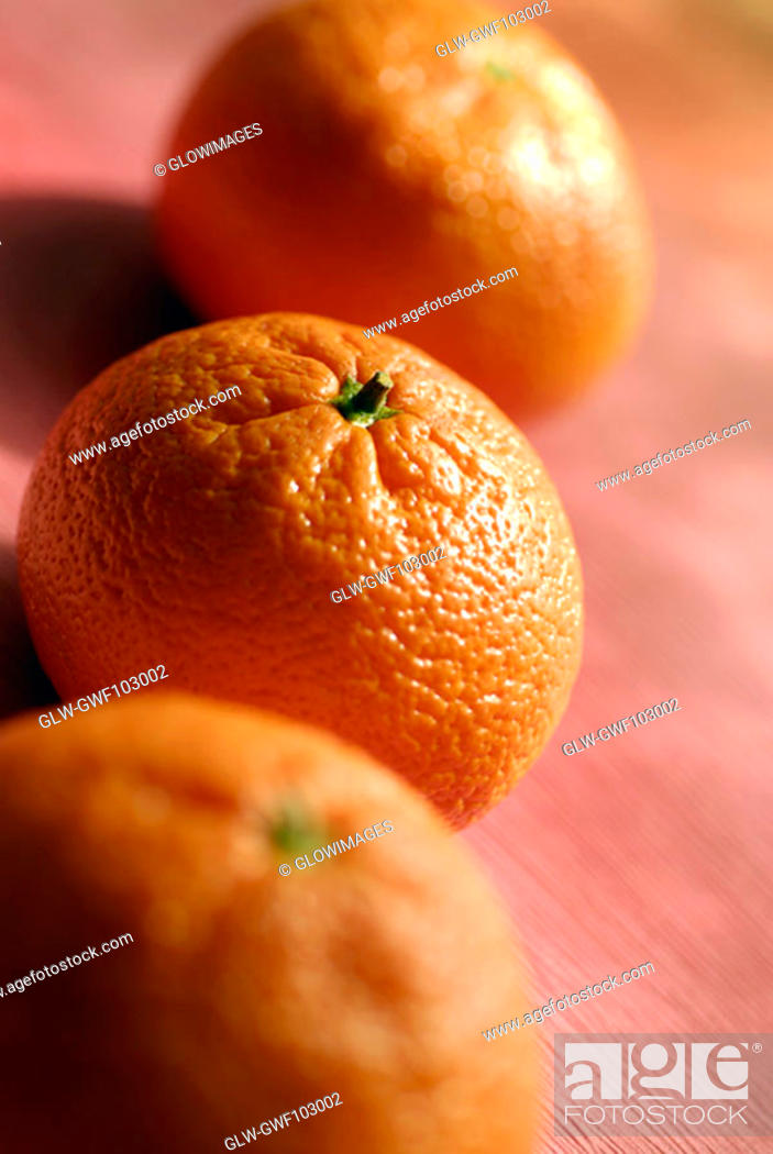 Stock Photo: High angle view of three oranges.