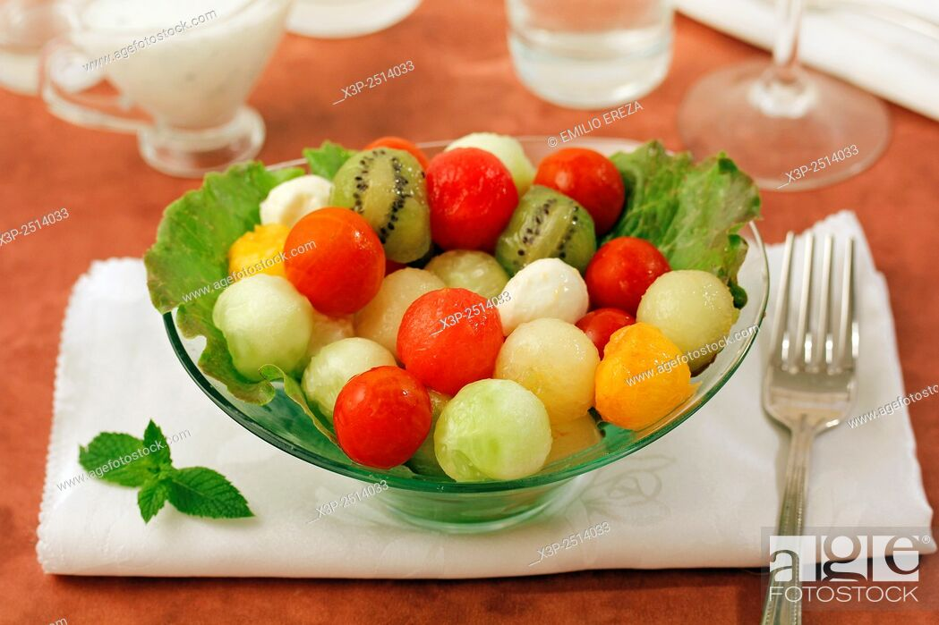 Stock Photo: Fruit salad with cheese and yogurt sauce. .