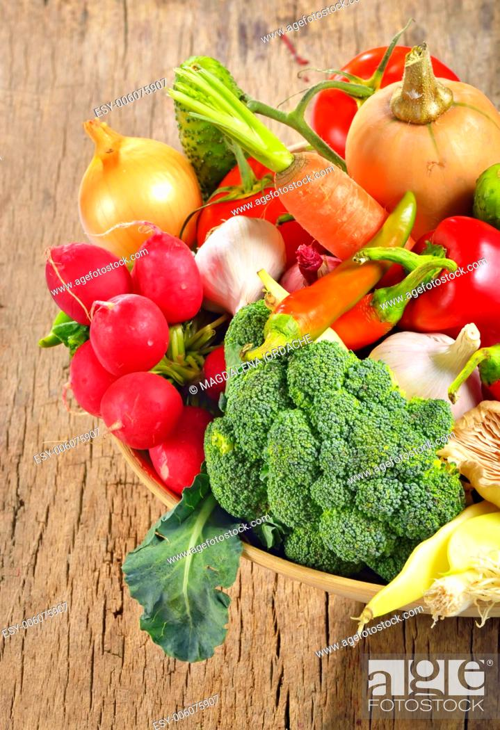 Stock Photo: fresh vegetables on wooden table.