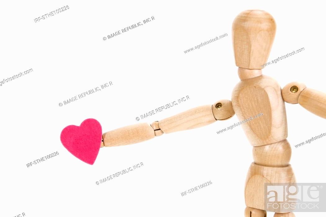 Stock Photo: heart shape and wooded doll.