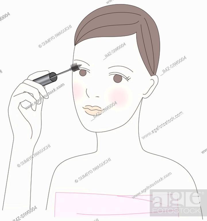 Stock Photo: Young woman applying mascara.