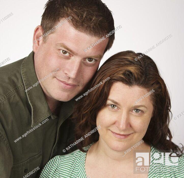Stock Photo: Loving married heterosexual couple posing for portrait.