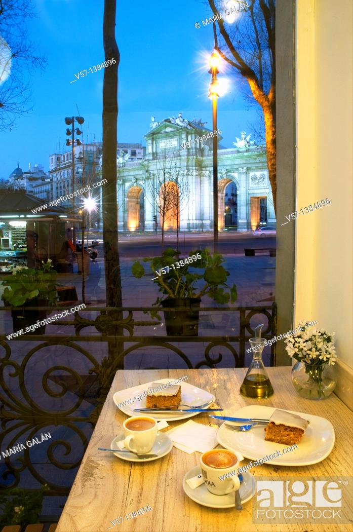 Stock Photo: Coffee with cake for two at dusk. Independencia Square, Madrid, Spain.
