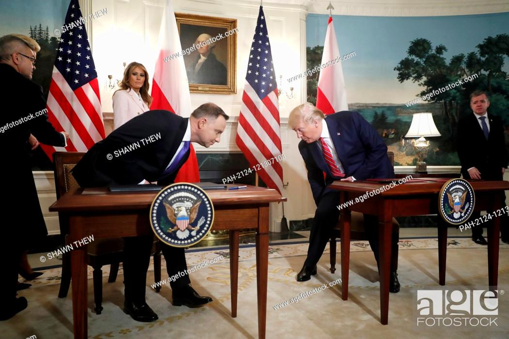Stock Photo: US President Donald J. Trump (R) and Polish President Andrzej Duda (L) arrive to participate in a signing ceremony in the Diplomatic Reception Room of the White.