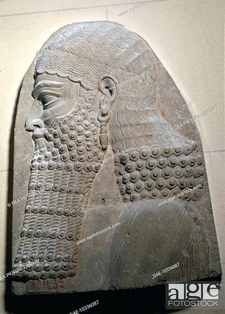Assyrian civilization, 8th century b C  Bearded head engraving in