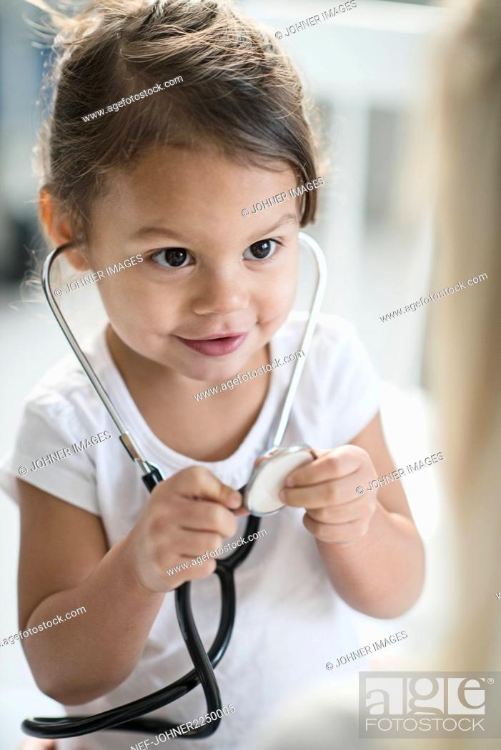 Stock Photo: Small girl with stethoscope.