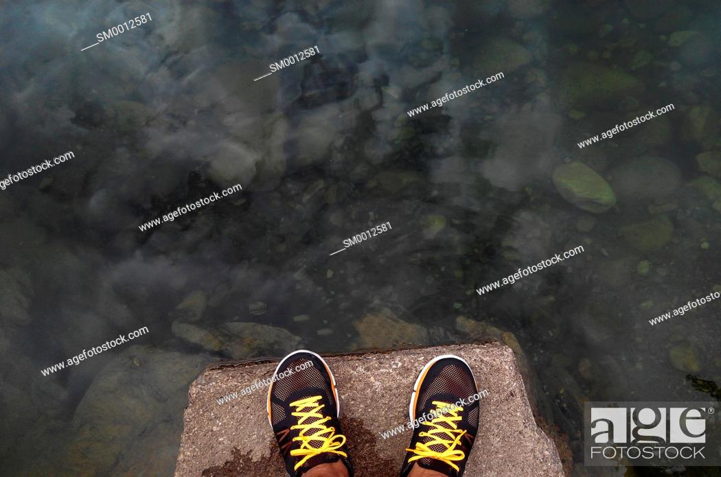 Stock Photo: Sneakers to the riverbank.