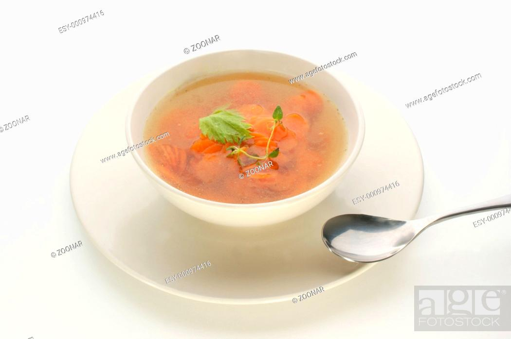 Stock Photo: carrot soup with organic herbs.