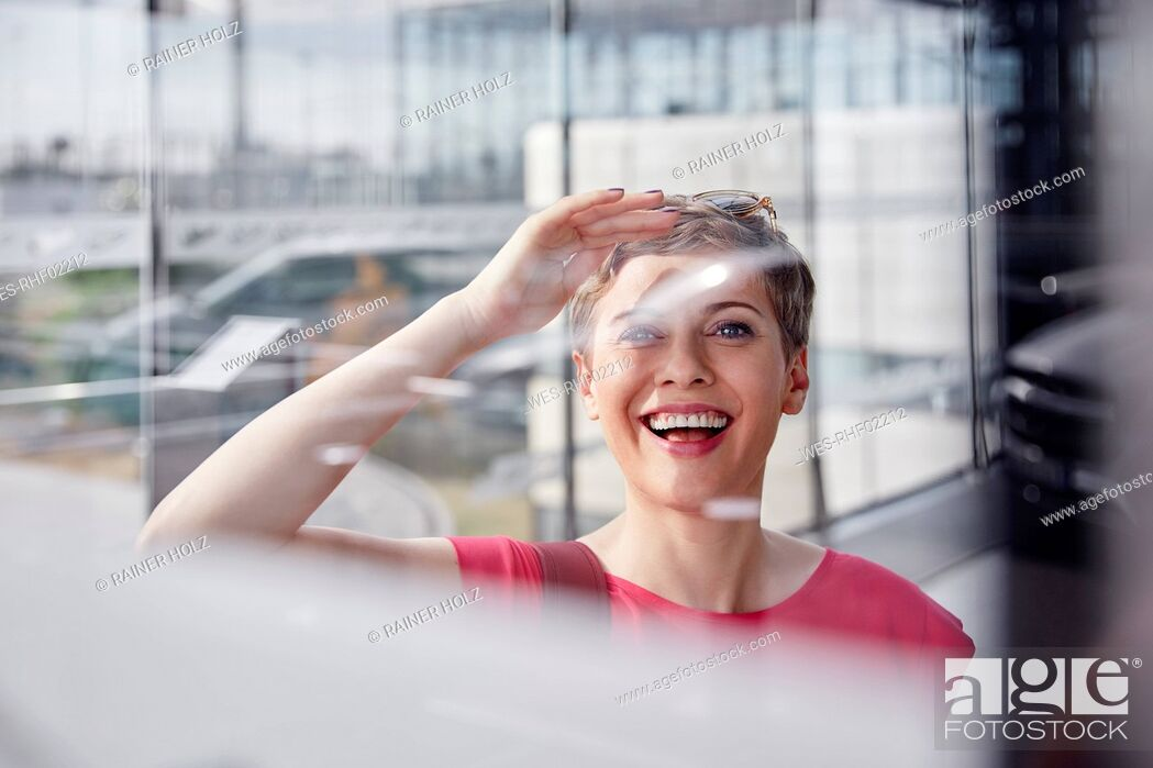 Stock Photo: Portrait of happy woman at the airport.