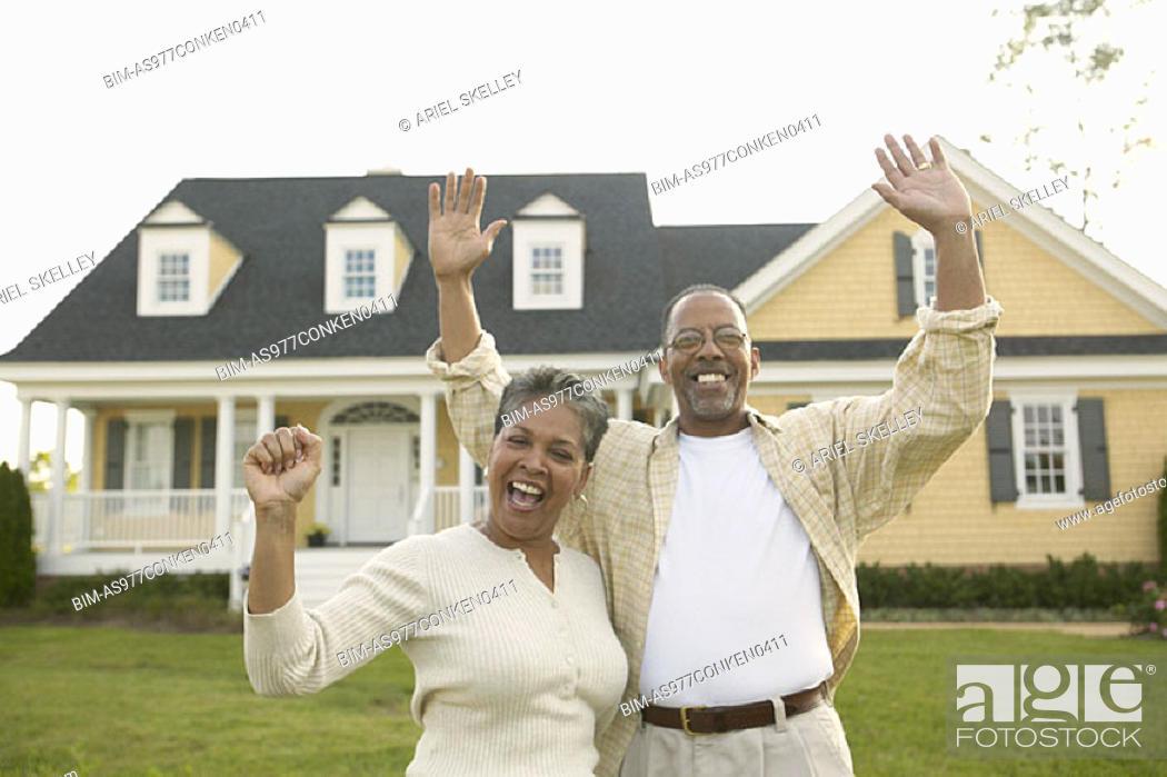 Stock Photo: Portrait of senior couple waving.
