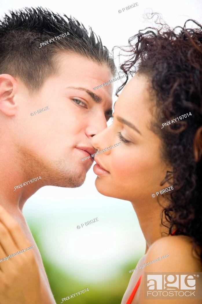 Stock Photo: Close-up of a couple about to kiss.