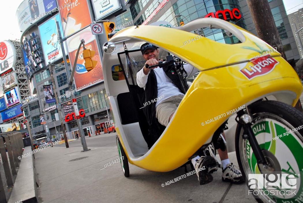 Stock Photo: Eco Bicycle Taxi at Dundas Square.