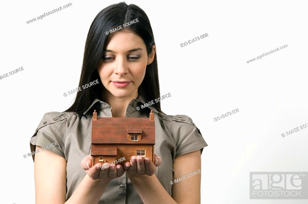 Stock Photo: Woman looking at model of house.