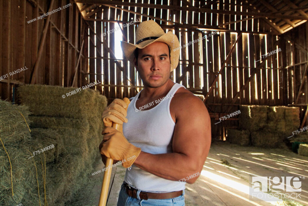 Stock Photo: Rancher cleaning the barn. Poway, California. USA.