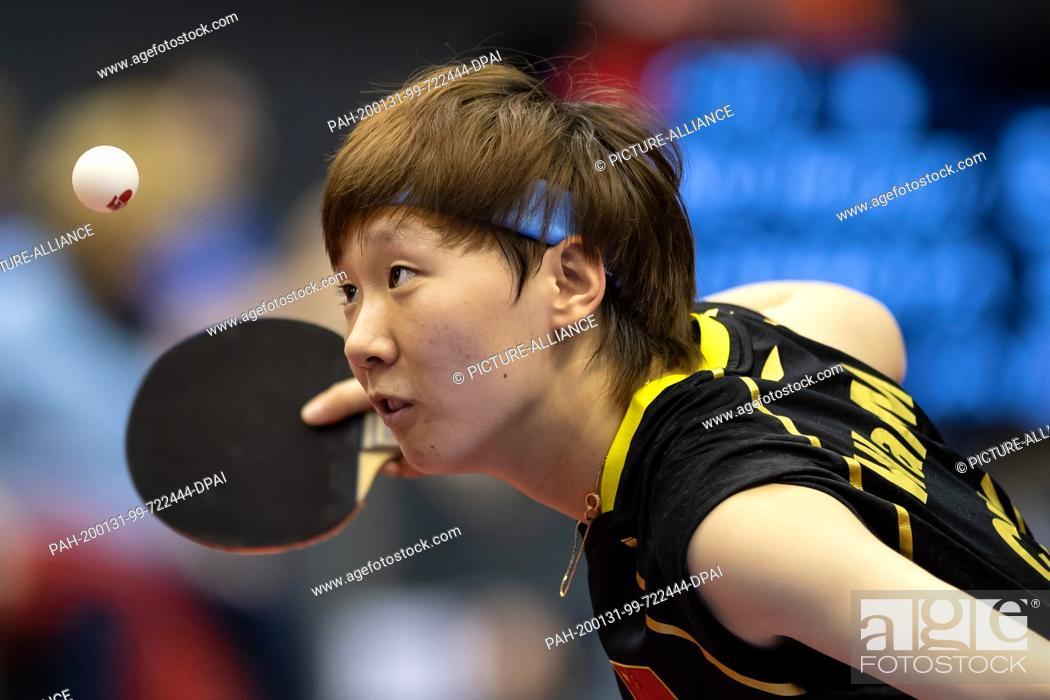 Stock Photo: 31 January 2020, Saxony-Anhalt, Magdeburg: Table tennis: German Open, women, singles, round of sixteen, Wang (China) - Shibata (Japan).